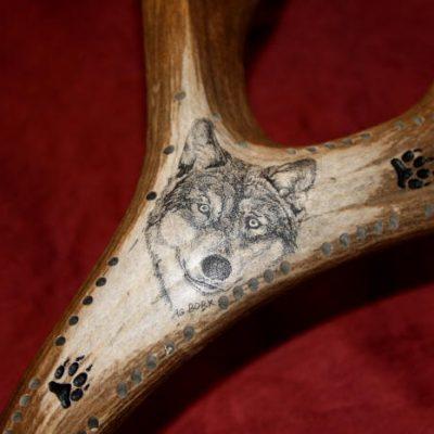 wolf scrimshaw on antler cribbage board